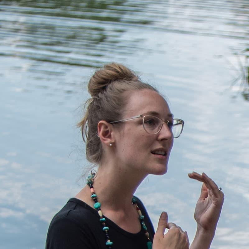 A woman standing by a lake